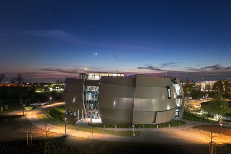 On 26 April 2018, the ESO Supernova Planetarium & Visitor Centre was officially inaugurated, and its doors are open to the public from 28 April 2018. The centre, located at ESO Headquarters in Garching, Germany, is a magnificent showcase of astronomy. It provides visitors with an immersive experience of astronomy in general, along with ESO-specific scientific results, projects, and technological breakthroughs. This spectacular evening picture, taken a few days before the opening, shows a conjunction of the planet Venus and the young crescent Moon in the background.
